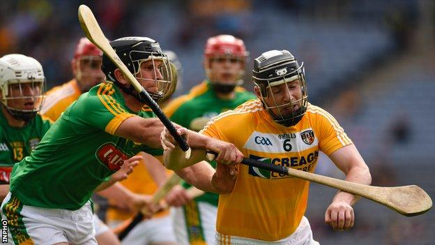 Meath's Joey Keena challenges Antrim's Neal McAuley at Croke Park