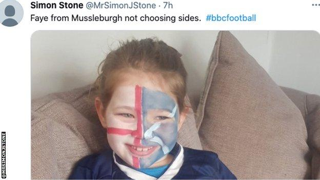 Young girl with England and Scotland flags painted on face.