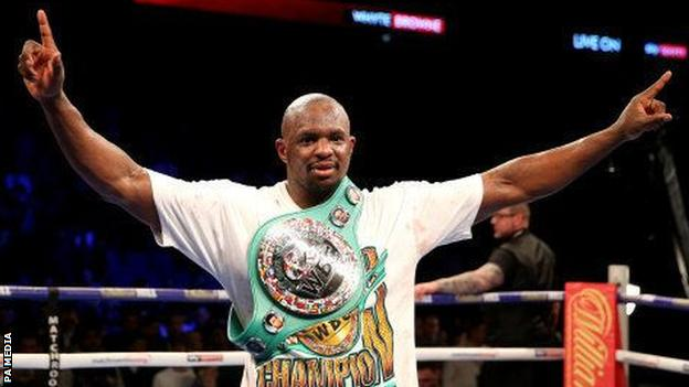 Dillian Whyte posing with the WBC interim world heavyweight belt