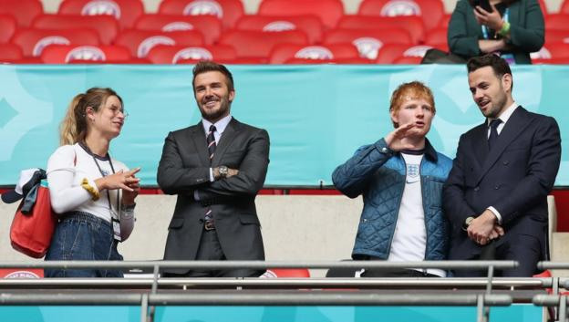 Cherry Seaborn, David Beckham and Ed Sheeran are seen in the stands at Wembley