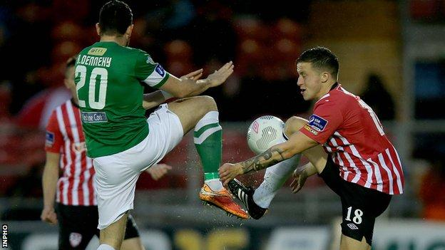 Cork's Billy Dennehy challenges Derry opponent Rob Cornwall