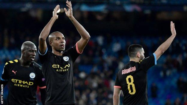 Man City players salute their fans at the final whistle in Madrid
