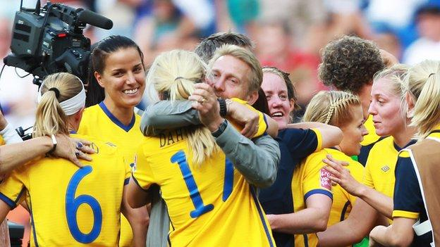 Coach Thomas Dennerby celebrates with his Swedish side at the 2011 Women's World Cup