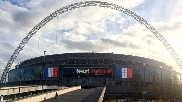 Wembley Stadium with the words 'Liberte, Egalite, Fraternite' written across it