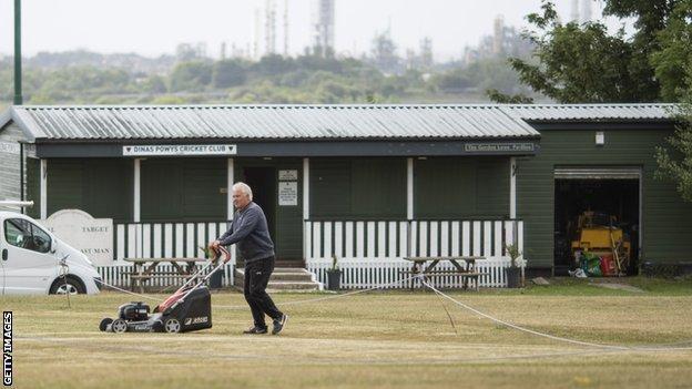 Groundsman prepares the pitch at Dinas Powys Cricket Club