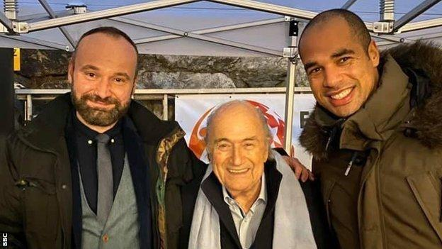 Former Fifa president Sepp Blatter and 'England' players Richard Plumley and Alan Adesalu. Blatter was born close to 2020 host village Gspon and is the tournament's honorary ambassador
