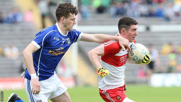Tiarnan Flanagan battles with Cavan's Donal Monahan in the Ulster Minor Final