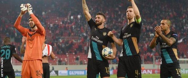 Theo Walcott, right, made his first start since October against Olympiakos