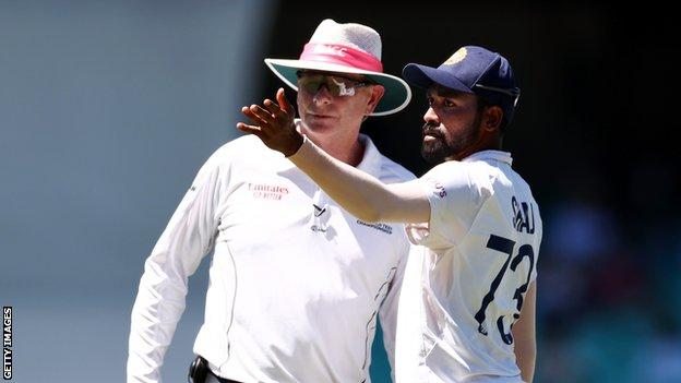 India fast bowler Mohammed Siraj (right) points to a section of the crowd while talking to umpire Paul Reiffel (left) after receiving alleged abuse during day four of the third Test against Australia
