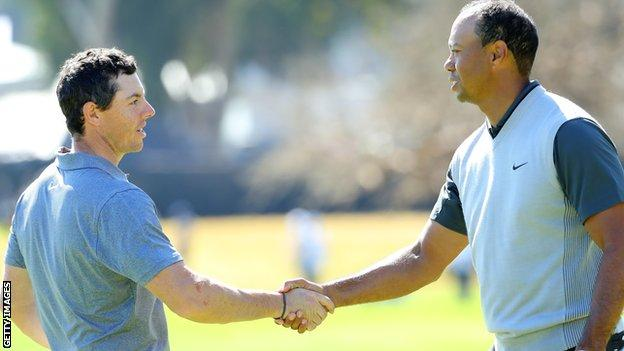 Rory McIlroy and Tiger Woods at the end of their opening round in California