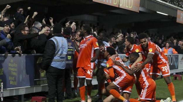 Shrewsbury Town celebrate after Luke Waterfall scoerd an 89th-minute winner against AFC Wimbledon