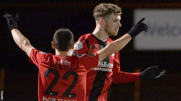 Jamie McGonigle celebrates his goal with Crusaders team-mate Paul Heatley