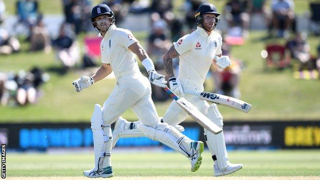 England batsmen Joe Denly (left) and Ben Stokes (right) look at the ball as they cross for a run on day one of the first Test against New Zealand