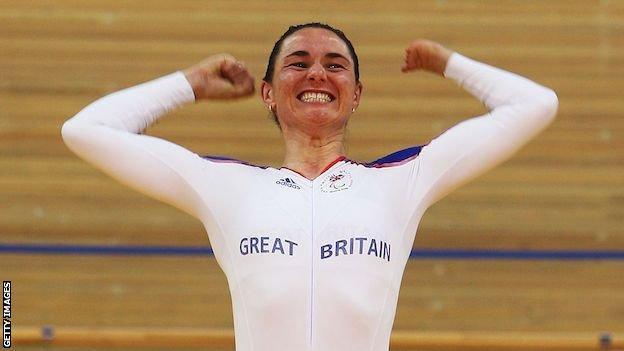 Sarah Storey celebrates on the podium at the velodrome at the Beijing 2008 Paralympics