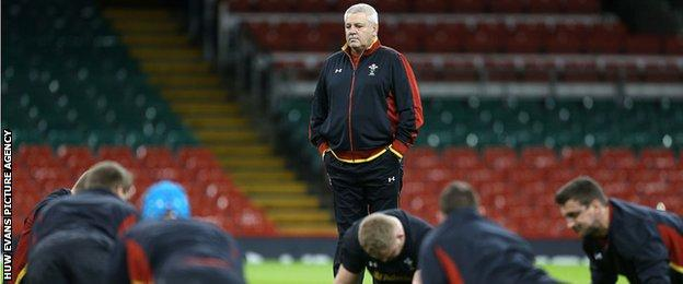 Warren Gatland watches the Wales team doing press-ups during a training session at the Millennium Stadium