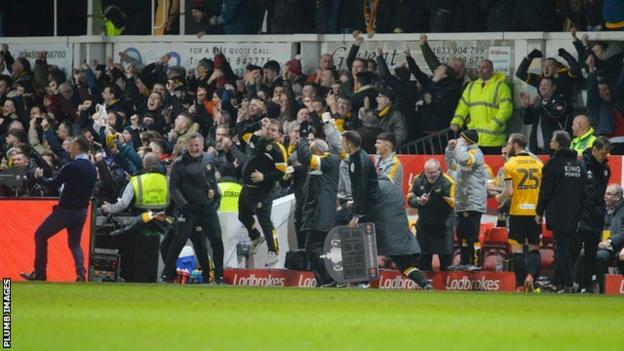 Newport manager Michael Flynn celebrates