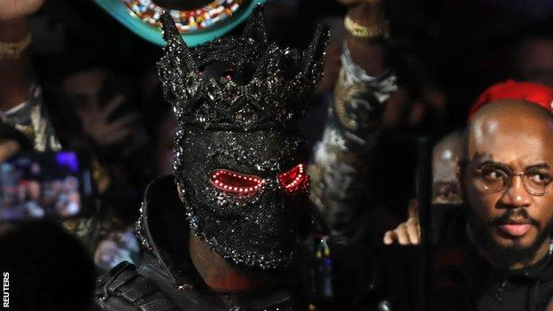 Deontay Wilder wearing a mask as he makes his entrance to the ring