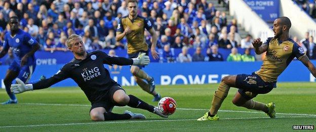 Kasper Schmeichel saves a shot from Arsenal's Theo Walcott