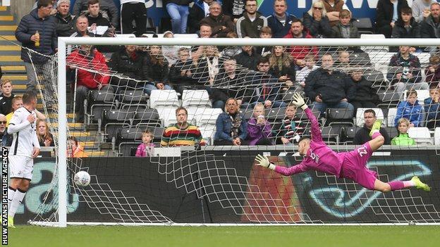 Swansea goalkeeper Freddie Woodman is beaten as Stoke's Sam Clucas equalises