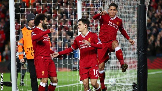 Philippe Coutinho celebrates his hat-trick goal against Spartak Moscow with Mohamed Salah and Roberto Firmino
