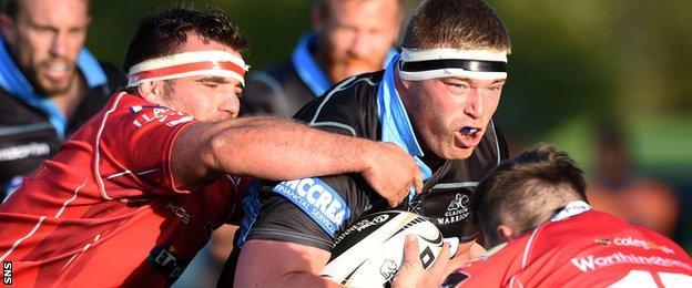 Scarlets tackle Glasgow's Alex Allen