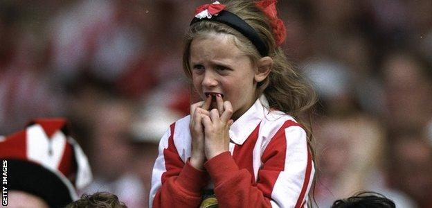 A young Sunderland fan crosses her fingers before the penalty shoot-out