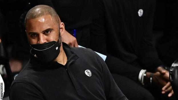 Ime Udoka wearing a face covering during the Covid-19 pandemic when he was an assistant coach with the Brooklyn Nets
