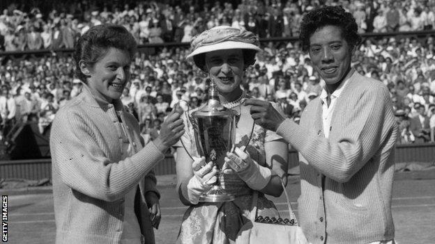 Angela Buxton and Althea Gibson with the Wimbledon doubles trophy