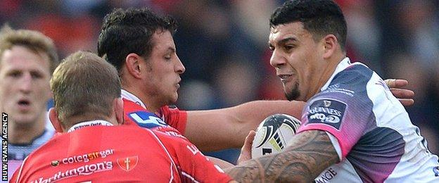 Ospreys centre Josh Matavesi is caught by Scarlets back-rowers Aaron Shingler and John Barclay