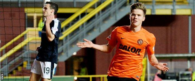 Blair Spittal heads off to celebrate scoring United's second goal against Dundee