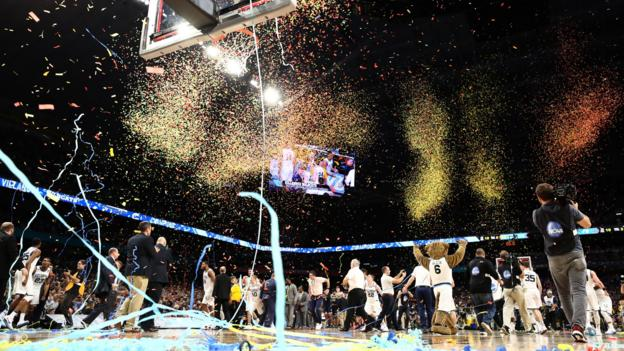 San Antonio, United States, 2 April: Confetti falls as the Villanova Wildcats celebrate after defeating the Michigan Wolverines during the NCAA Men's Final Four National Championship game at the Alamodome in Texas.