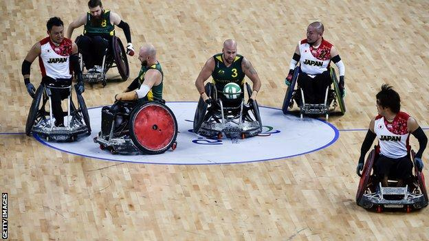 Wheelchair rugby players from Australia and Japan compete during the semi-final at the Rio Paralympic Games