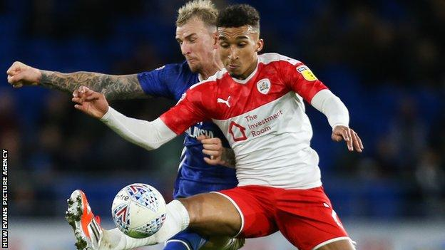Cardiff's Aden Flint in action against Jacob Brown