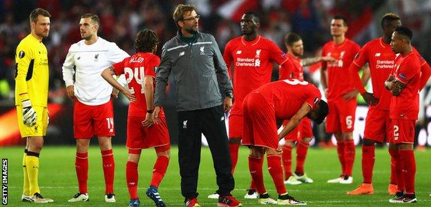 Liverpool manager Jurgen Klopp with his defeated players after the final whistle of the Europa League final