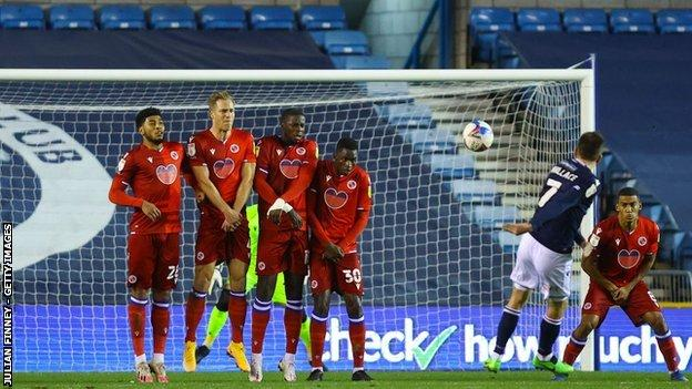 Millwall top scorer Jed Wallace's fifth goal of the season put the Lions ahead against Reading at The Den