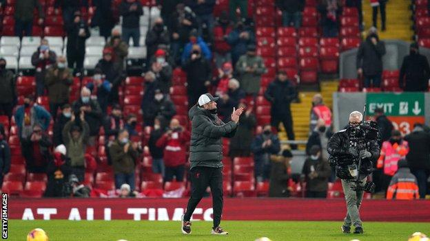 Jurgen Klopp applauds the fans at Anfield