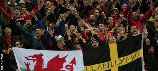 Wales fans celebrating in Bosnia-Herzegovina