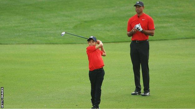 Tiger Woods (right) looks on as his son Charlie (left) plays a shot at the PNC Championship second round in Florida