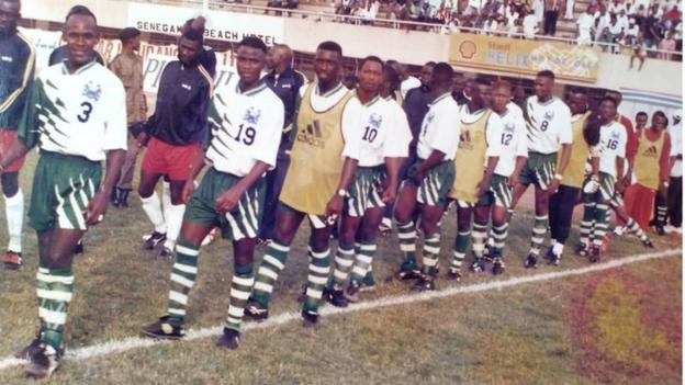 Ernest Kamara (19) second in line walking out to play for Sierra Leone against The Gambia in 2001