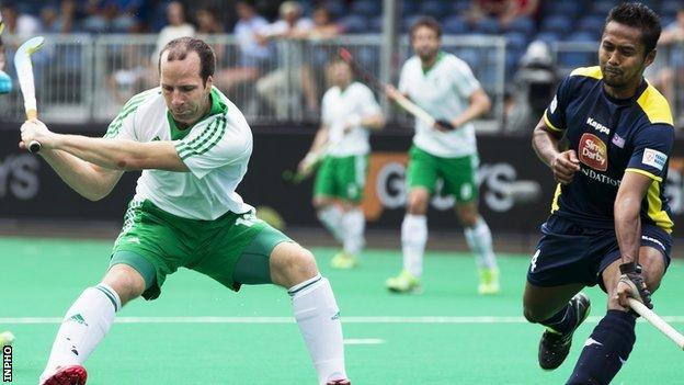 Peter Caruth prepares to score Ireland's second goal against Malaysia in the first quarter