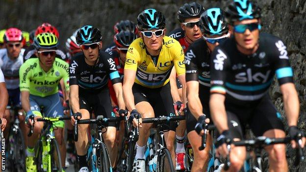 Geraint Thomas (yellow jersey) with Team Sky team-mates at the head of the Peloton during stage seven