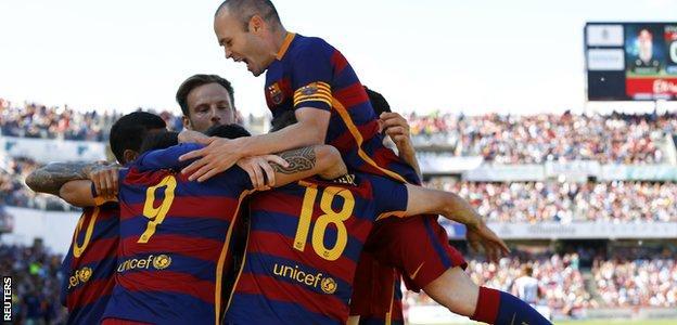 Barcelona players celebrate their third goal