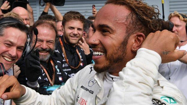 Lewis Hamilton celebrates winning the Italian GP