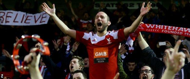 Whitehawk fans celebrate drawing at Dagenham and Redbridge in the FA Cup