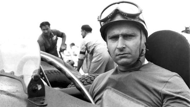 The racing driver Fangio in the cockpit
