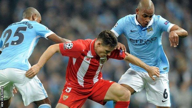 Manchester City duo Fernando and Fernandinho in action together against Sevilla