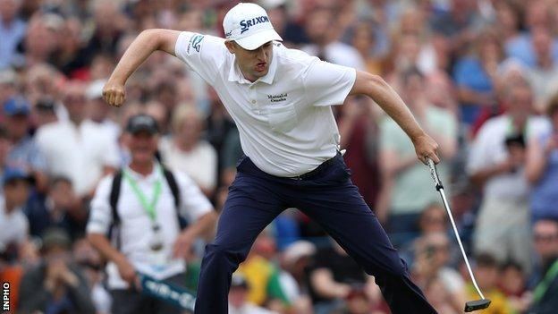 Russell Knox celebrates holing the winning putt on the 18th hole