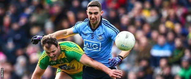 Donegal's Michael Murphy battles with Dublin's James McCarthy