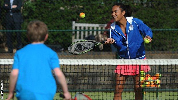 Heather Watson coaches a young child
