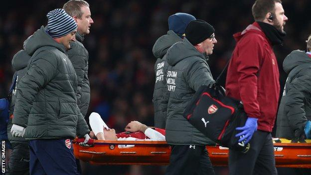 Hector Bellerin: Arsenal defender out for up to nine months after rupturing ACL